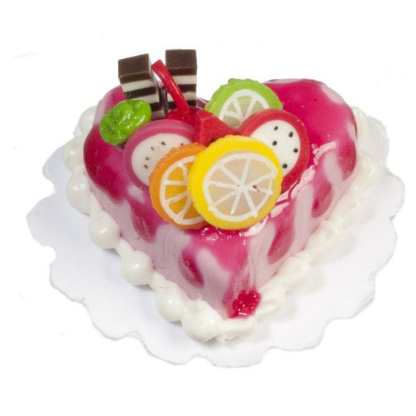 A dollhouse miniature heart-shaped cake.