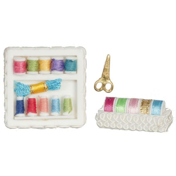 A dollhouse miniature sewing kit.