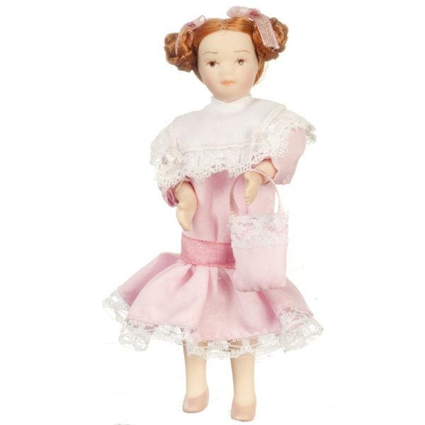 A porcelain dollhouse doll who is a young girl wearing a pink Victorian dress.