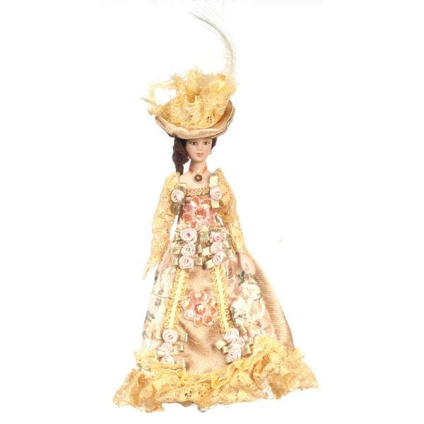 A porcelain dollhouse doll in a yellow floral Victorian dress and big hat.