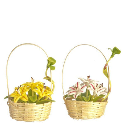 Two dollhouse miniature baskets with lilies in them.