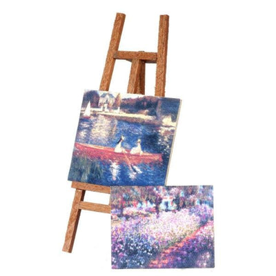 A dollhouse miniature easel with two floral paintings.
