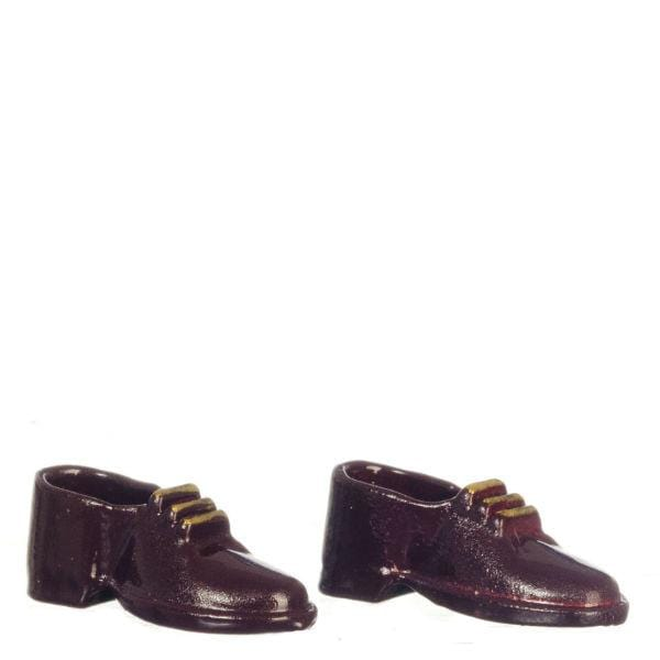 Brown men's shoes in miniature doll size.