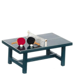 A dollhouse miniature ping pong table with two paddles and balls.
