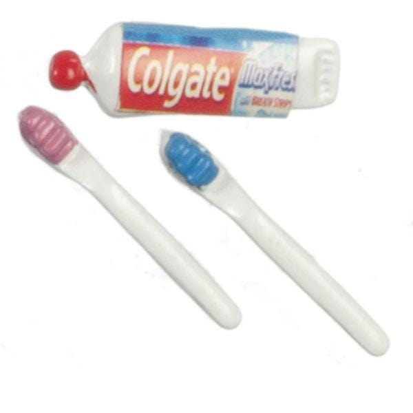 Dollhouse miniature toothbrushes and toothpaste.