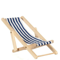 A dollhouse miniature outdoor lounge chair with navy and white stripes.