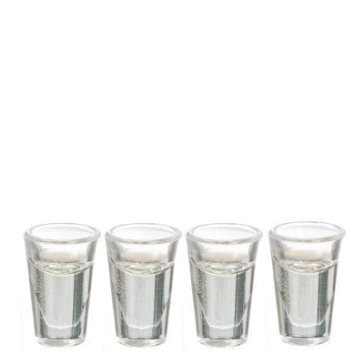 Four plastic dollhouse miniature water glasses filled with fake water.