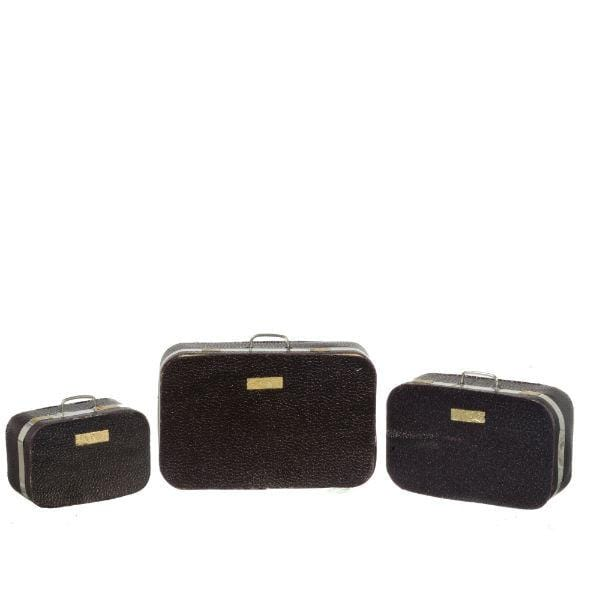 A set of three suitcases sized for dolls.