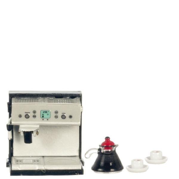A dollhouse miniature coffee machine with coffee pot and two coffee cups.