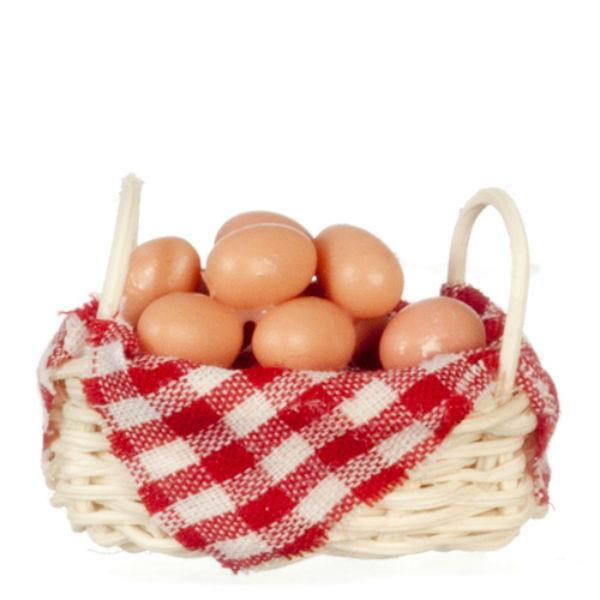 A dollhouse miniature basket of brown eggs.