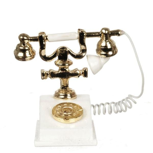 A dollhouse miniature old-fashioned white phone.