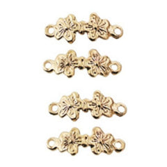 Four gold-plated dollhouse miniature floral drawer pulls.