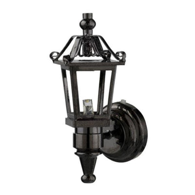 A dollhouse miniature black coach lamp.