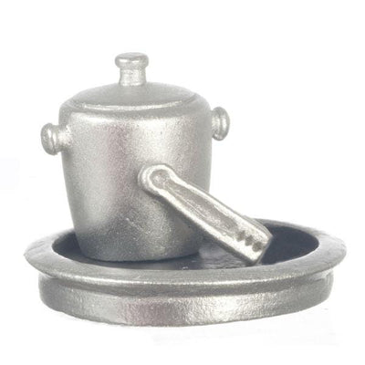 A silver resin dollhouse miniature ice bucket, tongs, and tray.
