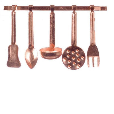 A six-piece dollhouse miniature copper kitchen utensil set.