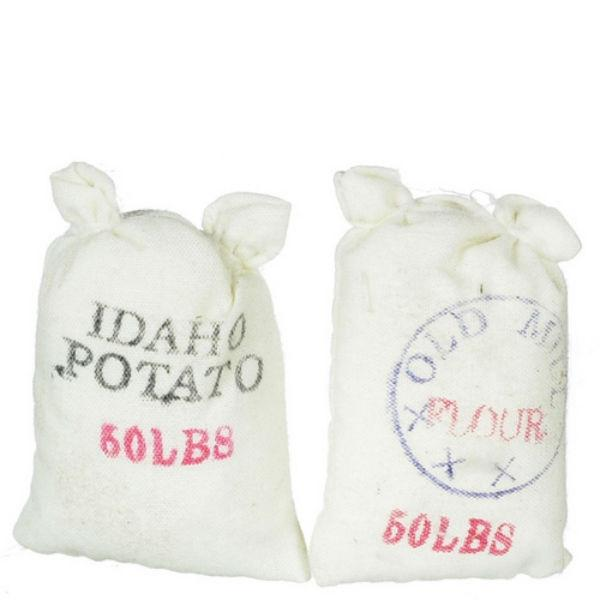 Two dollhouse miniature sacks of potatoes and flour.