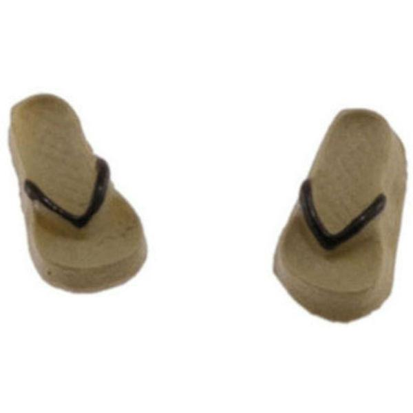 Tan and black doll clothing flip flops.