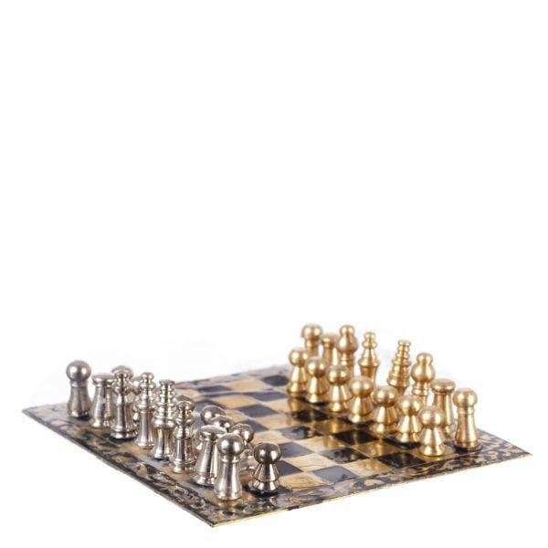 A dollhouse miniature magnetic chess board.