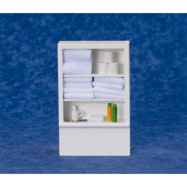 A dollhouse miniature white bath shelf with towels.