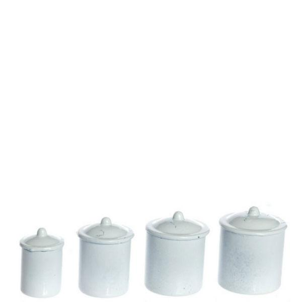 A set of four white dollhouse miniature canisters.