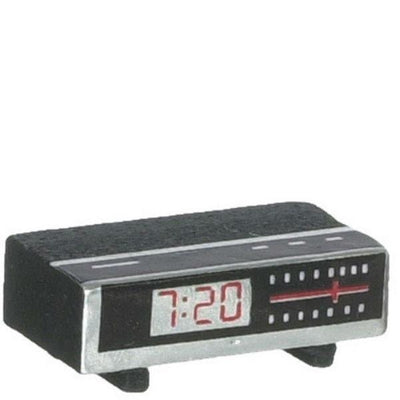 A dollhouse miniature clock radio.