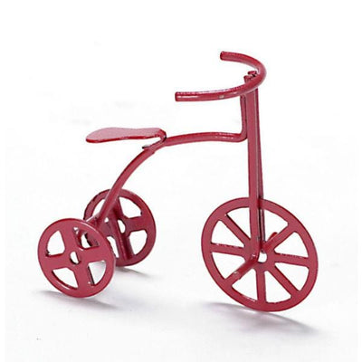 A dollhouse miniature red tricycle.
