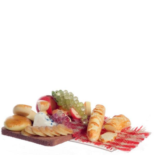 Dollhouse miniature cheese board that is 1/24 scale.