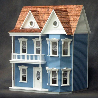 The exterior of an assembled wooden dollhouse kit.