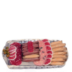 A dollhouse miniature meat tray.