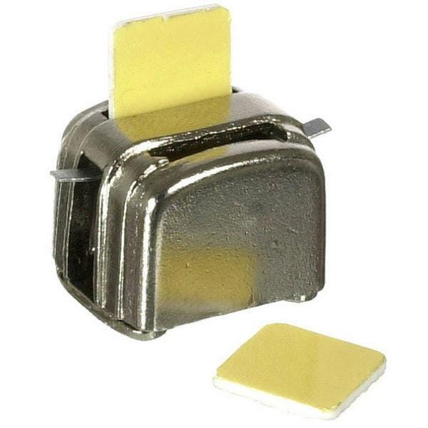 A dollhouse miniature metal toaster with two pieces of toast.