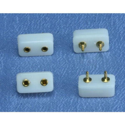 Four dollhouse miniature plug-in receptacles.