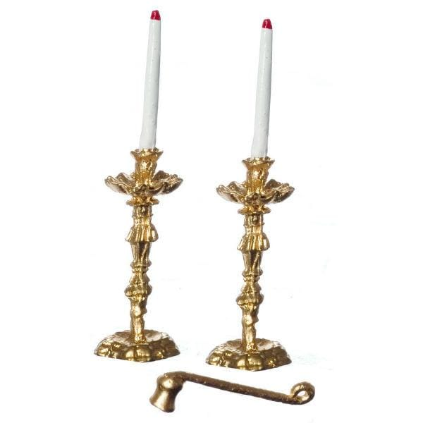 Two dollhouse miniature candles in gold candle holders and a snuffer.