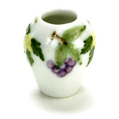 A dollhouse miniature vase with a grape design on it.
