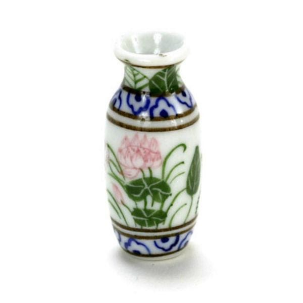 A dollhouse miniature vase with a water lily design.