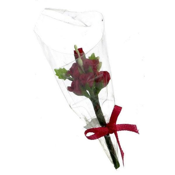 A dollhouse miniature bouquet of six red roses.