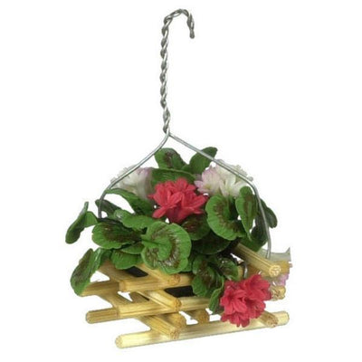 A dollhouse miniature hanging wooden basket of red geraniums.