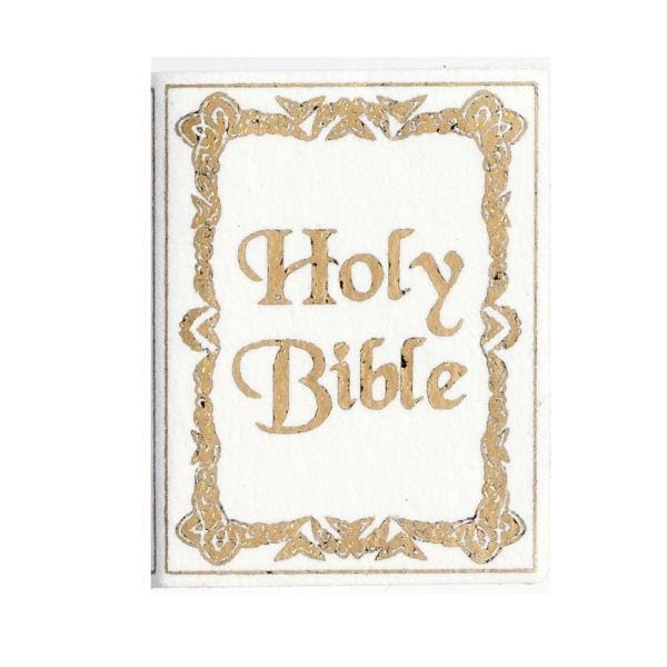 A white miniature Holy Bible.