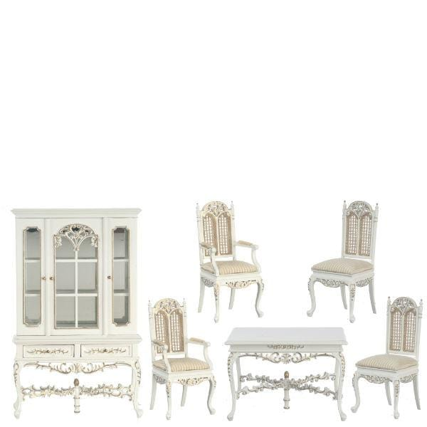 A dollhouse furniture dining room set with white table and four chairs and a walnut display cabinet.