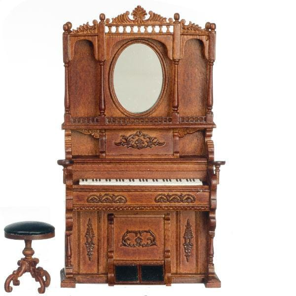 A walnut dollhouse furniture piano and stool.