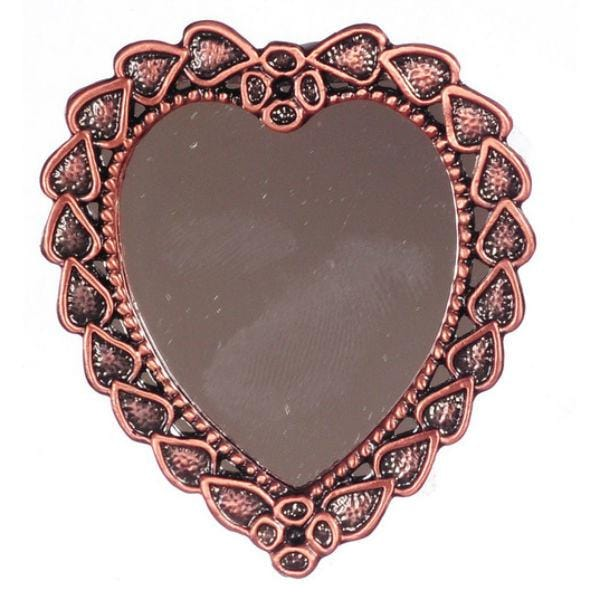 A copper dollhouse miniature mirror shaped like a heart.