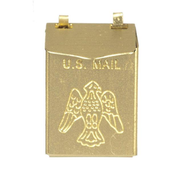 A brass dollhouse miniature mailbox.