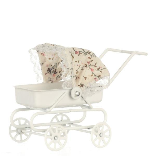 A dollhouse miniature baby carriage with a floral top.
