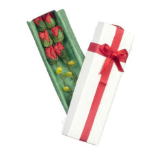 A dollhouse miniature gift box of red roses.