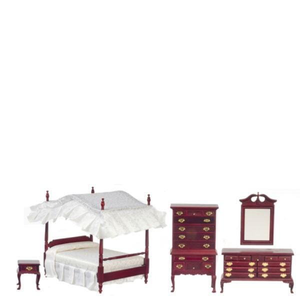 A dollhouse furniture set that includes a canopy bed, two dressers, mirror, and nightstand.