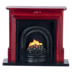 A dollhouse furniture fireplace with fire insert.