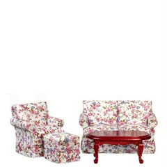 A dollhouse furniture living room set with floral fabric that includes an armchair, ottoman, sofa, and coffee table.