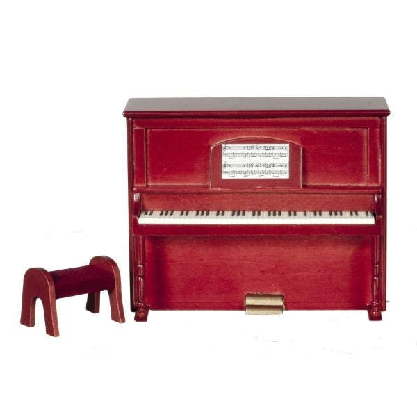 A dollhouse furniture piano with a bench and sheet music.