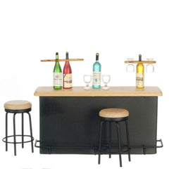 A dollhouse furniture 1950s bar set with a counter, two stools, and five bottles of alcohol with glasses.