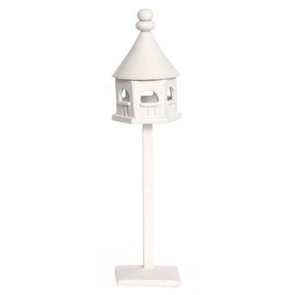 A white dollhouse miniature birdhouse.