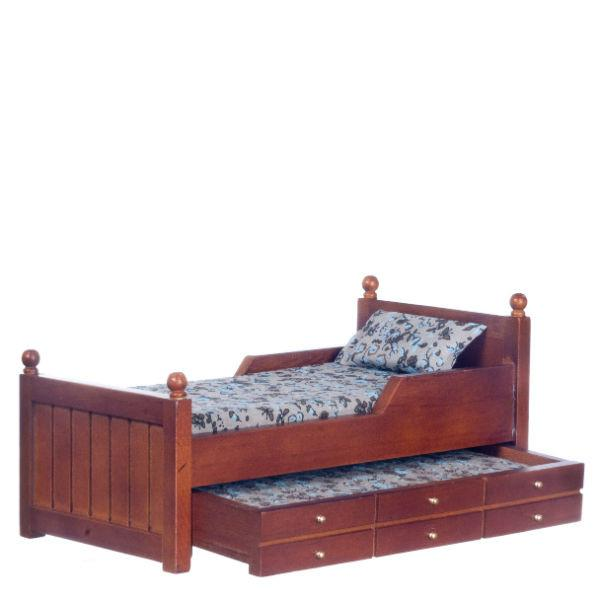 A dollhouse furniture trundle bed in a dark walnut finish.